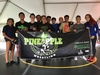 Photo of Lanai wrestlers holding Pineapple Wrestling Club banner.