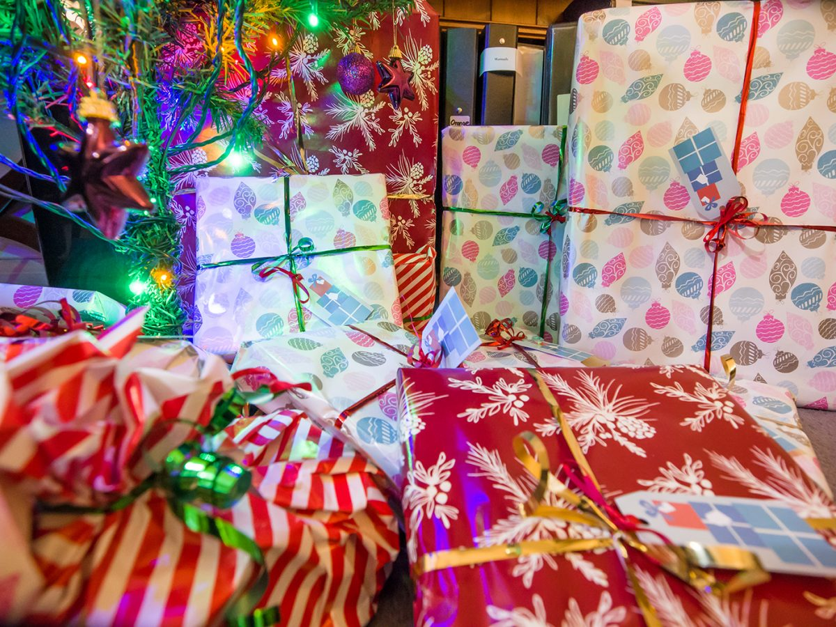 Photo of wrapped Christmas gifts under tree