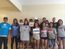 Photo of Lanai seniors wearing college shirts.