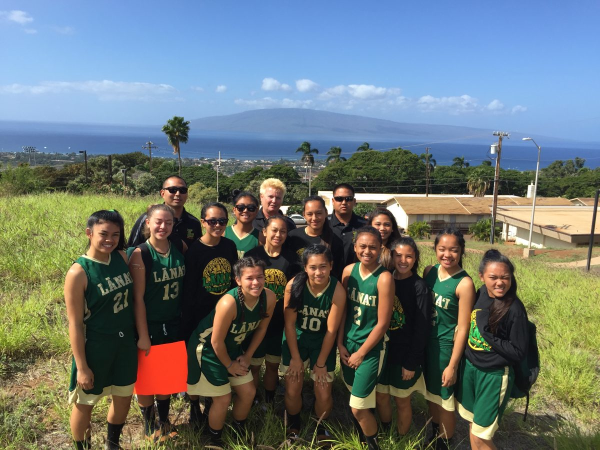 Photo of Lanai girls basketball team in uniforms on Lanai field.