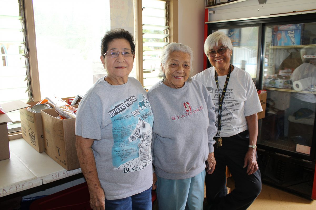 Photo of Soledad Obado at Lanai Food Pantry with volunteers.