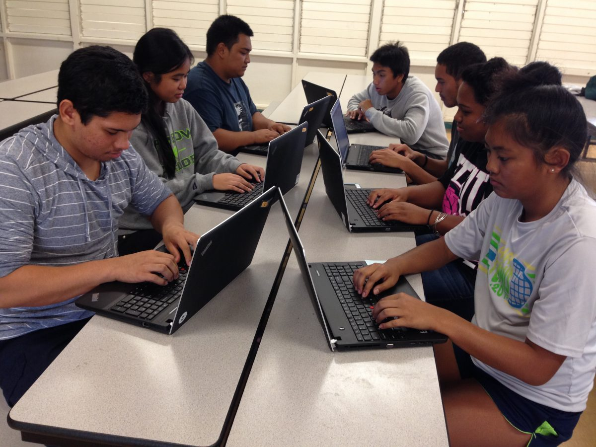 Photo of group of Lanai students on laptops sitting at desks.