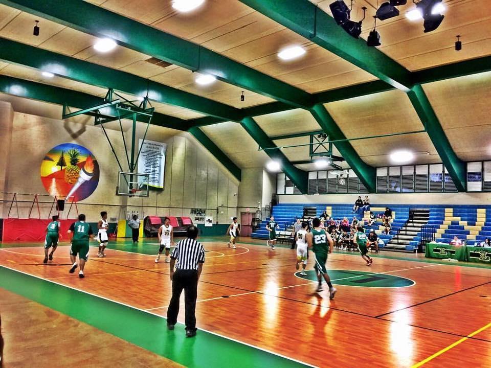 Lanai boys basketball team playing at Lanai high school gym