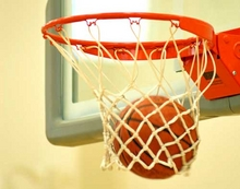 Photo of basketball going through hoop.