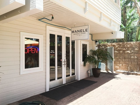 Photo of exterior sign and entrance to Manele General Store.