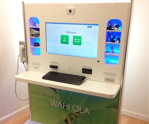 "Photo of Lanai Well medical kiosk with screen and ""Wahi Ola"" signage."