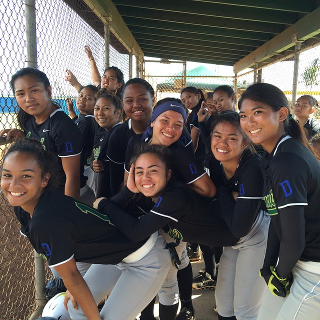 Photo of Lanai High Pine Lasses softball team in dugout.