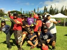 Photo of kickball team posing outside on field.
