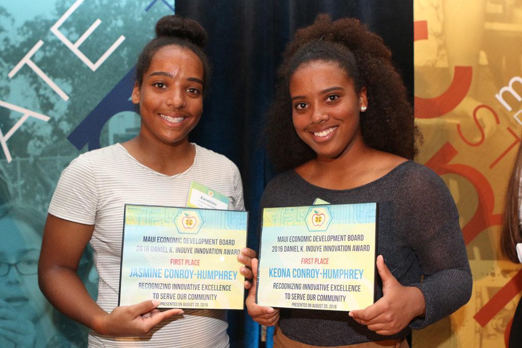 Photo of Jasmine and Keona Conroy-Humphrey with Daniel K Inouye Award.