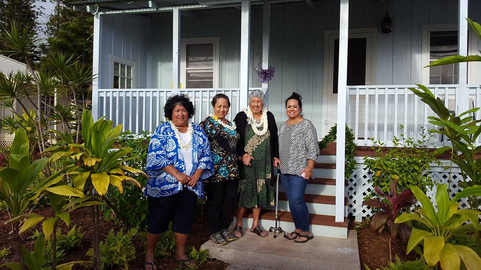 Photograph of Women Helping Women Lanai staff members in front of shelter.
