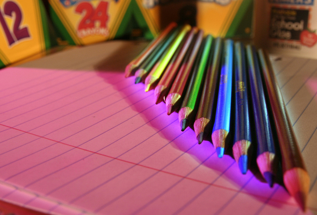 Photo of assorted color pencils on lined notebook paper.