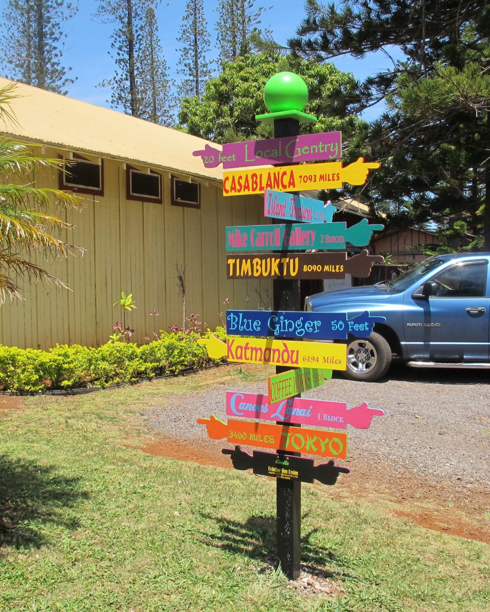 Photo of colorful business signs in Dole Square in Lanai City.