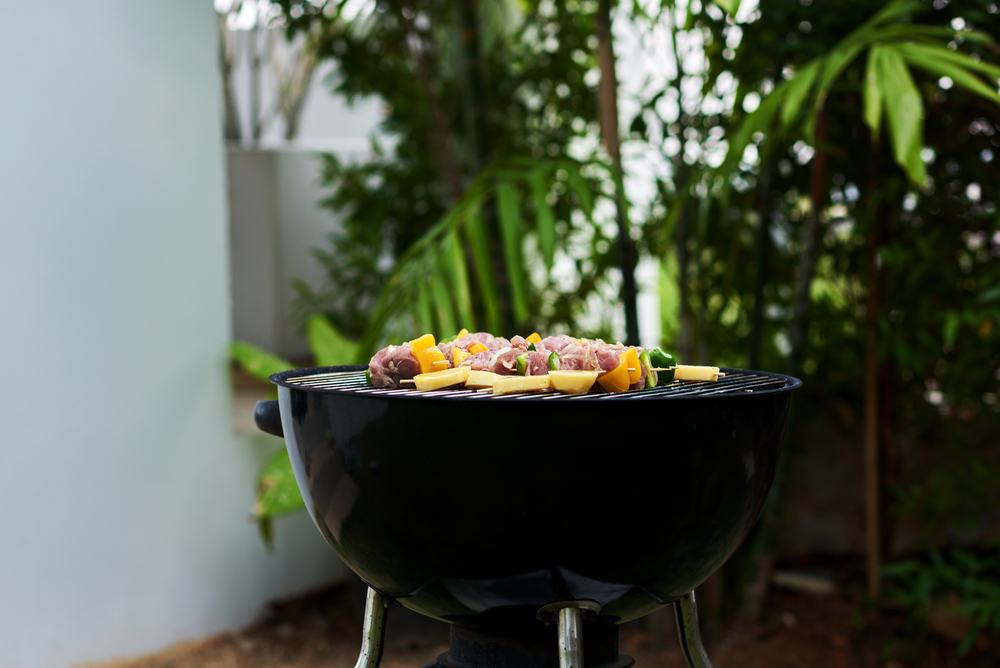 Photo of barbecue grill with food at Lanai party.